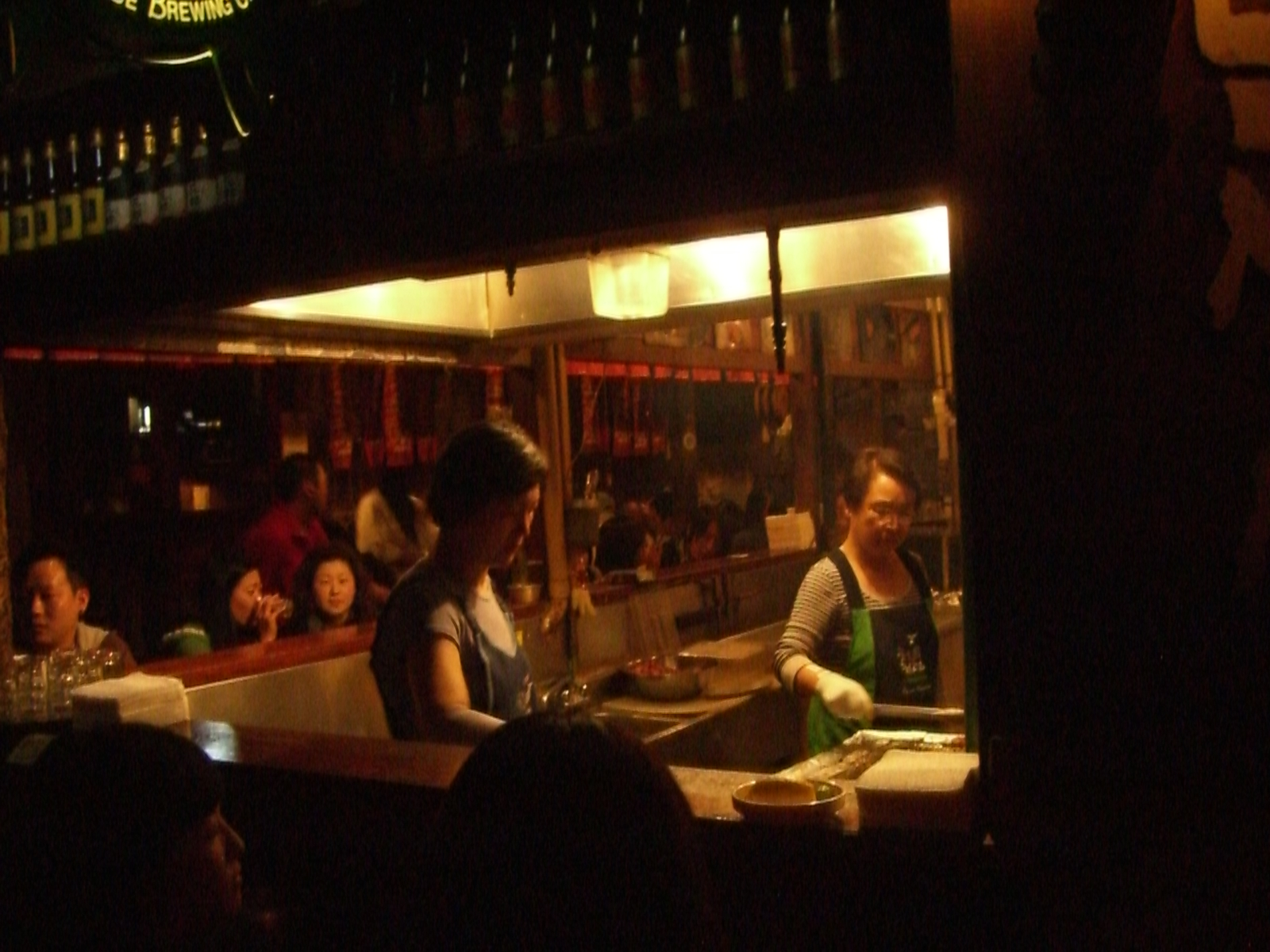 The ladies who does yakitori grill away for the late drinkers